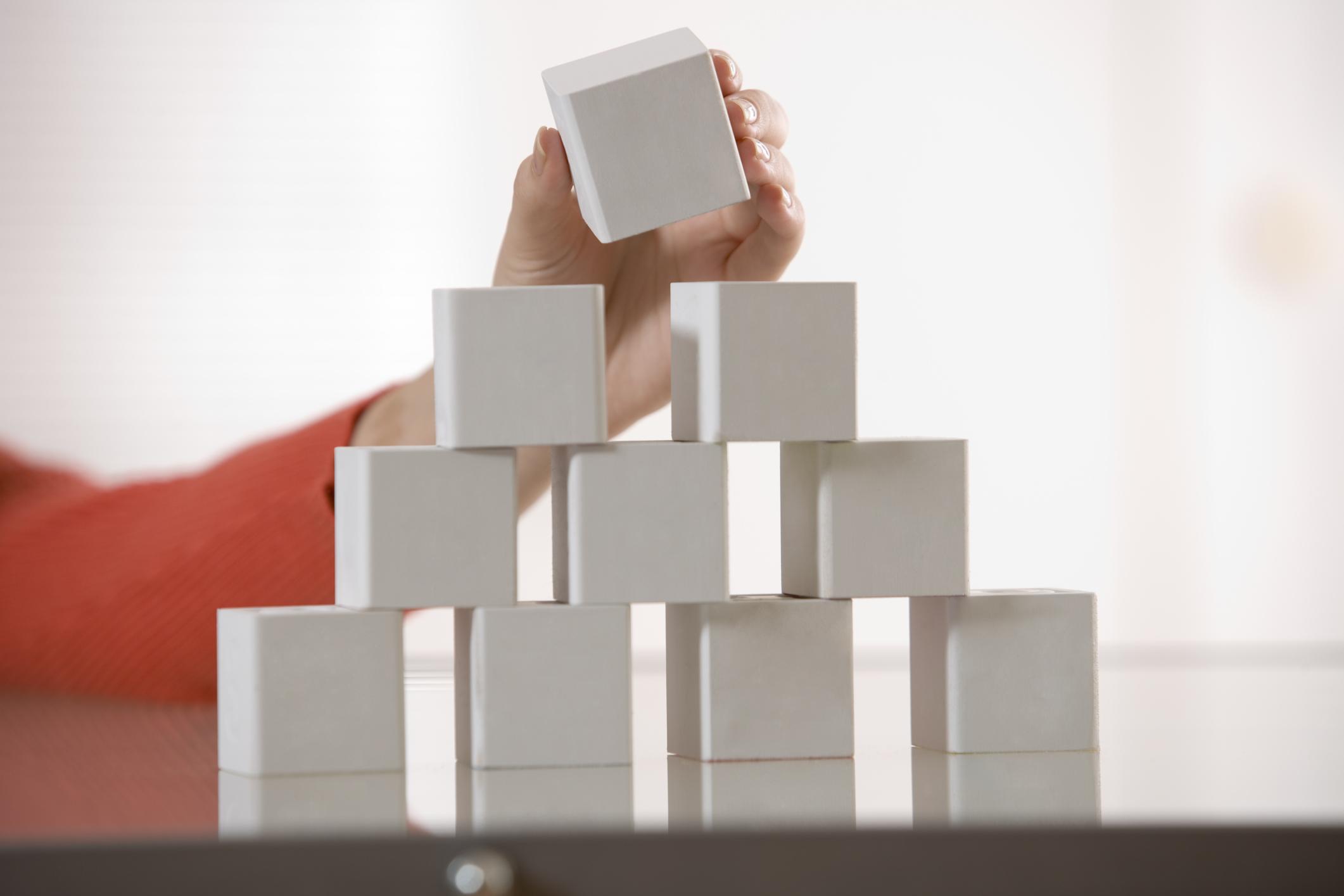 Hand stacking blocks